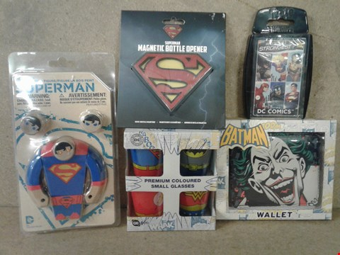 Lot 485 5 BRAND NEW ITEMS TO INCLUDE SUPERMAN MAGNETIC BOTTLE OPENER , SUPERMAN PAINTED WOOD FIGURE , DC COMICS TOP TRUMPS , PREMIUM COLOURED SHOT GLASSES AND BATMAN THE JOKER WALLET