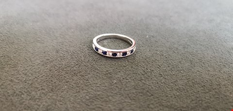 Lot 78 PLATINUM HALF ETERNITY RING SET WITH ALTERNATING DIAMONDS AND SAPPHIRES TOTAL WEIGHT +0.56CT  RRP £2140.00