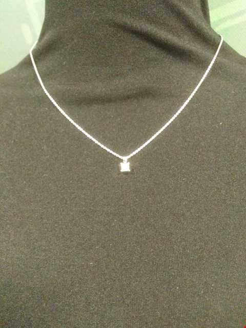 Lot 23 18CT WHITE GOLD PENDANT ON CHAIN SET WITH A PRINCESS CUT DIAMOND RRP £1050.00