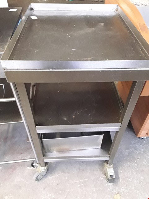 Lot 8 COMMERCIAL STAINLESS STEEL WHEELED TABLE WITH STORAGE SHELFS