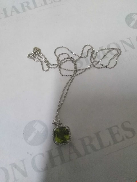 Lot 15 9CT WHITE GOLD PENDANT ON CHAIN, THE PERIDOT SET WITHIN A DIAMOND HALO. TOTAL WEIGHT +1.72CT RRP £705.00