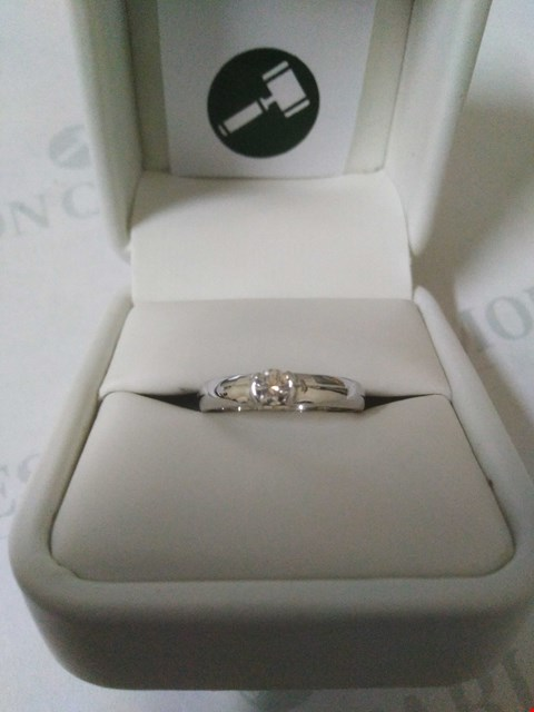 Lot 41 18CT WHITE GOLD SOLITAIRE RING SET WITH A DIAMOND  RRP £900.00