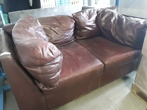 Lot 270 DESIGNER OXBLOOD LEATHER TWO SEATER SOFA