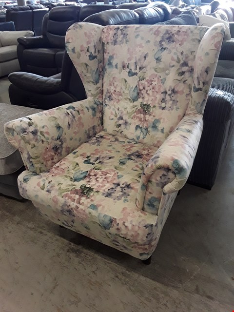 Lot 58 DESIGNER FLORAL FABRIC WINGED EASY CHAIR
