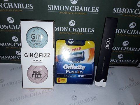 Lot 82 BOX OF ASSORTED COSMETIC ITEMS TO INCLUDE GIN&FIZZ LIP BALMS, GULLETTE FUSION PROGLIDE, VOID HOMME BEARD FILLER PENCIL ETC