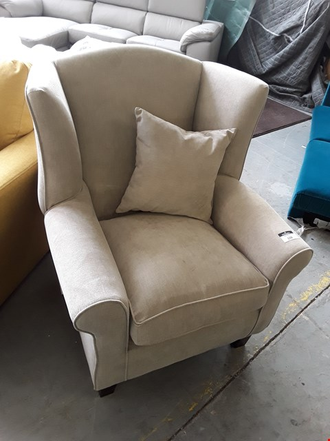 Lot 108 DESIGNER BEIGE FABRIC COMPACT WING BACK ARMCHAIR