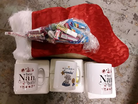 "Lot 2163 LOT OF 4 ASSORTED GRADE 1 ITEMS TO INCLUDE PERSONALISED CHRISTMAS SWEETIE STOCKING, 2 PERSONALISED ""BEST NAN"" MUGS, PERSONALISED ""ME TO YOU GRANDAD"" MUG RRP £62"