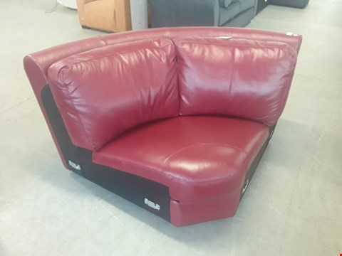 Lot 84 DESIGNER RED FAUX LEATHER CORNER SOFA SECTION.