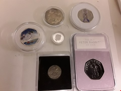 Lot 9379 SIX COINS, INCLUDING, 2019 PETER RABBIT 50P, 2016 PETER RABBIT 50P, 2018 SNOWMAN 50P, 1973 CLASPED HANDS 50P, 2017 GIBRALTAR 10 POUND COIN & SILVER 1956 SIXPENCE.
