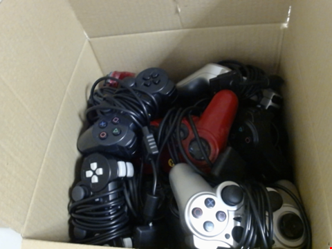 Lot 7755 QUANTITY OF ASSORTED 3RD PARTY PS2 PLAYSTATION 2 CONTROLLERS 30 X 30 X 30CM BOX