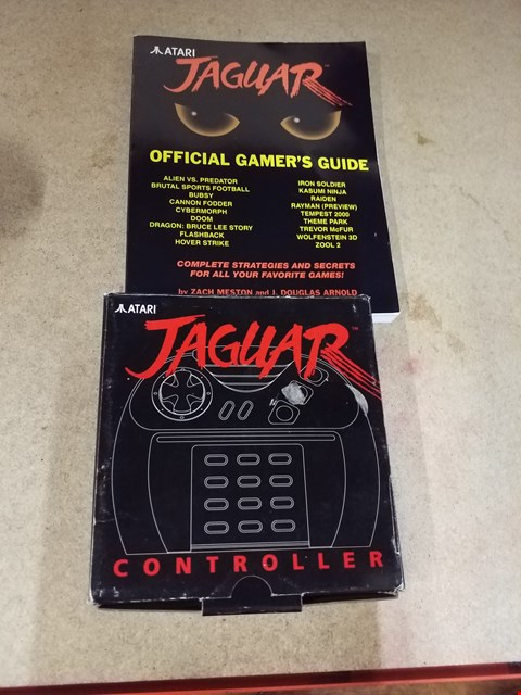 Lot 2039 A ATARI OFFICIAL GAMERS GUIDE AND A JAGUAR CONTROLLER