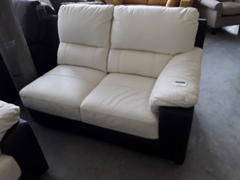 Lot 135 DESIGNER TWO TONE CREAM AND BLACK FAUX LEATHER SOFA SECTION