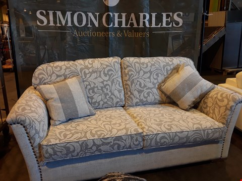 Lot 1007 DESIGNER JOHN FLEMING UPHOLSTERY CHATSWORTH BEIGE FLORAL FABRIC THREE SEATER SOFA WITH STUDDED DETAIL & 2 SCATTER CUSHIONS