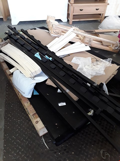 Lot 359 PALLET OF ASSORTED BEDFRAME PARTS TO INCLUDE A BLACK CRUSHED VELVET HEADBOARD ETC