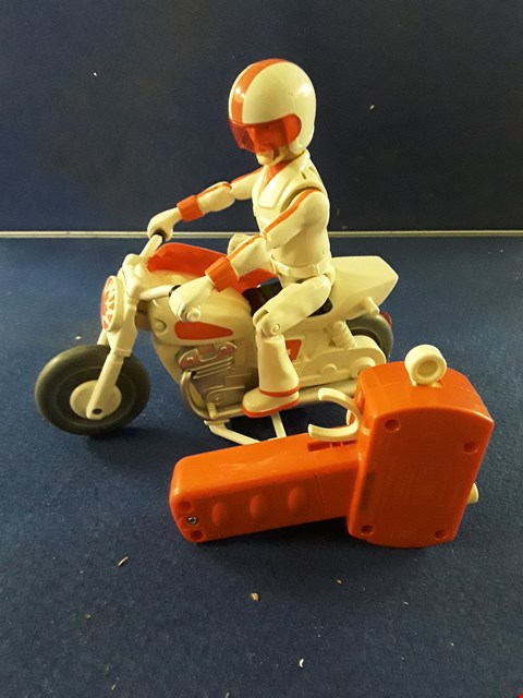 Lot 8724 TOY STORY 4 DUKE CABOOM RC MOTORCYCLE TOY