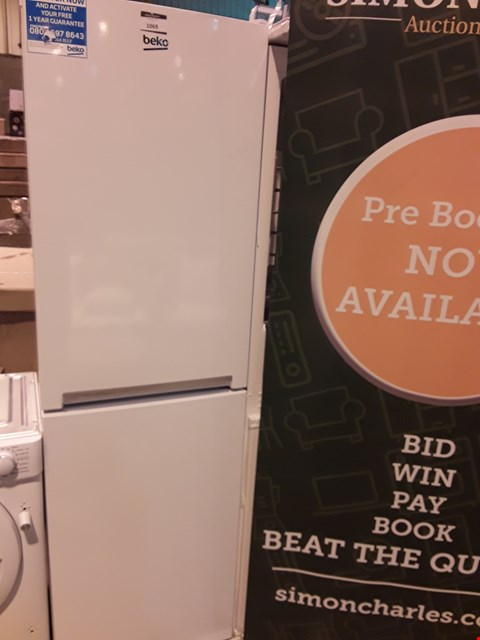Lot 1069 BEKO WHITE TALL 50/50 FRIDGE FREEZER CFG1582W