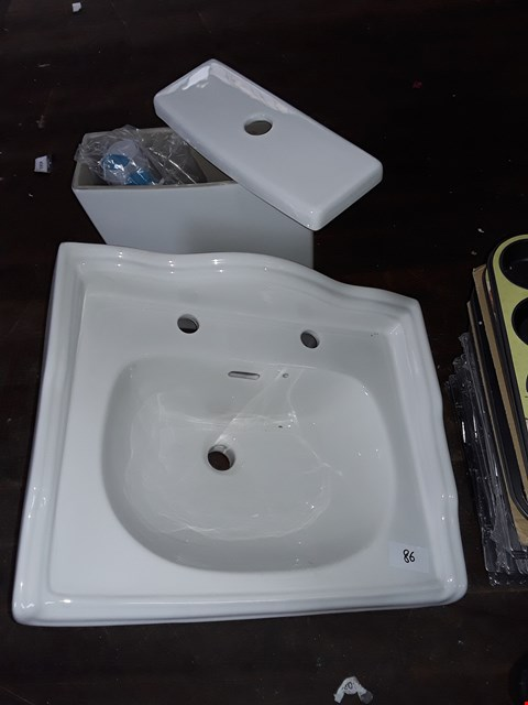 Lot 86 LOT OF 2 BATHROOM ITEMS INCLUDES CISTERN AND CERAMIC 2-TAP BASIN WITH RAISED EDGES AND OVERFLOW