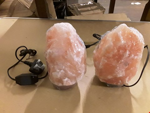 Lot 57 LOT OF 2 HIMALAYAN SALT LAMPS ON WOODEN BASES