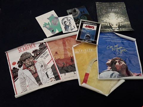 Lot 35 APPROXIMATELY 9 FILM-RELATED POSTERS AND CANVASES, INCLUDING CALL ME BY YOUR NAME AND JAWS