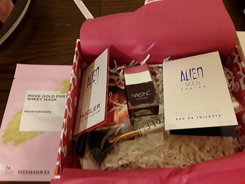 Lot 7027 GLOSSY BOX IYS ALL ABOUT LOVE BOX CONTAINS ROSE GOLD DUST SHEET MASK, NAILSINC LONDON NAIL POLISH AND HUDA BEAUTY LIP CONTOUR ECT