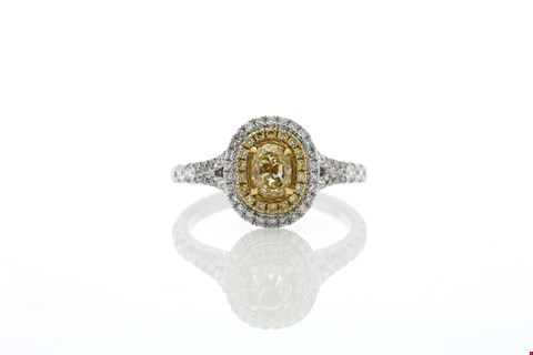 Lot 9 18ct FANCY YELLOW OVAL DIAMOND RING SET IN AN 18ct WHITE GOLD HALO SETTING (0.56ct) 1.03ct TOTAL RRP £21250